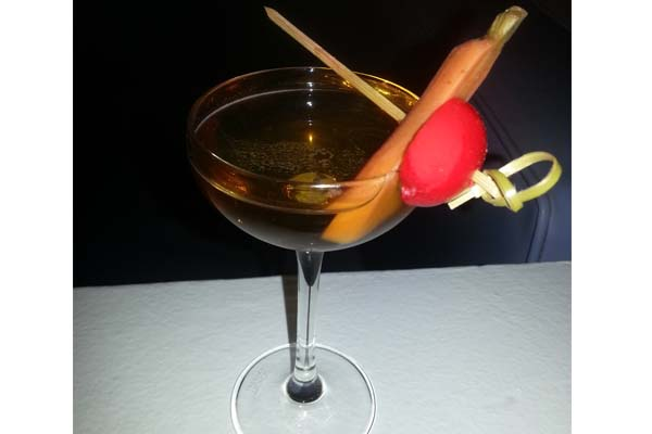 The Apokreas cocktail, made from metaxa, verjus and maple syrup with red pickled quail egg and baby carrots, is Zaytinya's special Greek Easter drink.