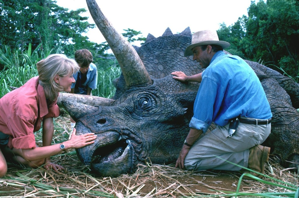 Paleontologists Alan Grant (Sam Neill) and Ellie Sattler (Laura Dern) examine a sick Triceratops. (Photo: Universal Pictures)