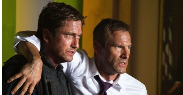 Agent Mike Banning (Gerard Butler) helps President Benjamin Asher (Aaron Eckhart) out of the White House after rescuing him from terrorists.
