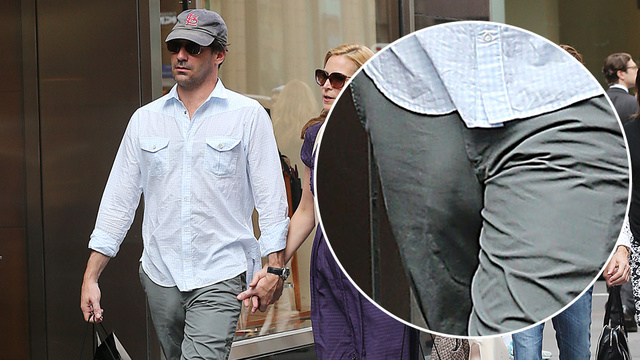 Mad Men  star Jon Hamm and longtime girlfriend Jennifer Westfeldt walk  along Madison Avenue.   35216ffd7c36