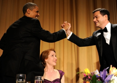 Host Jimmy Kimmel gives President Barack Obama a high five during the 2012 White House Correspondents Dinner.
