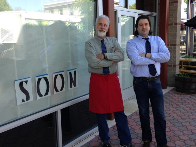 Owner Mike Anderson, left, and business partner, Bill Blackburn, right, stand in front of their future sushi bar Thursday in Del Ray. (Photo by WTOP)