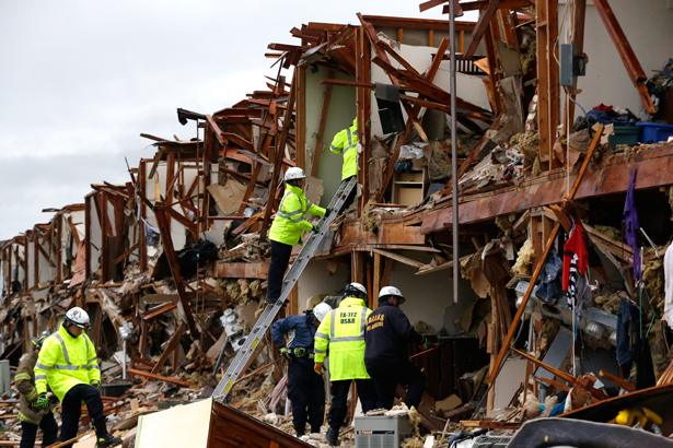 Firefighters conduct search and rescue of an apartment destroyed by an explosion at a fertilizer plant in West, Texas, Thursday, April 18, 2013. (AP Photo/LM Otero.)