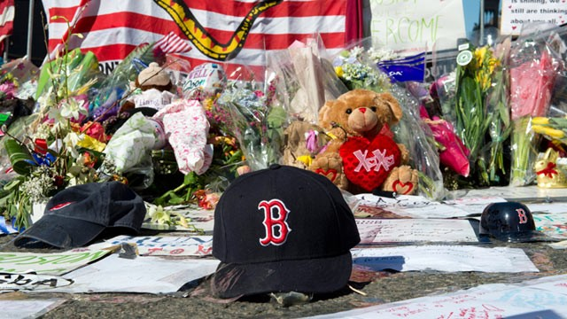 A Boston Red Sox cap left at a makeshift memorial on the Boston Marathon route, April 18, 2013, in Boston. (Don Emmert/AFP/Getty Images)