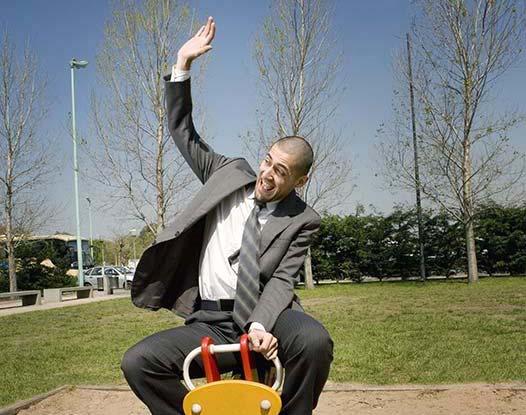 man on a playground ride