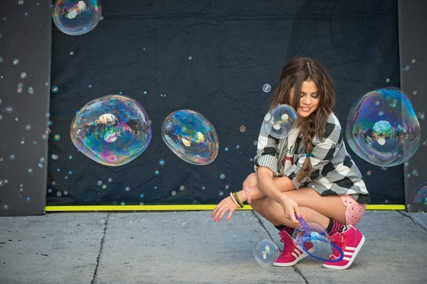 Selina Gomez in her pink Adidas NEOs.