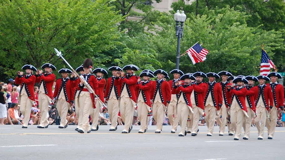 Colonial reenactors march in a previous National Independence Day parade. (Photo by  Miller Taylor)