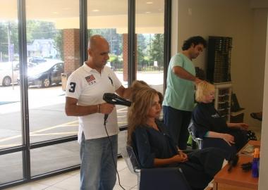 Salon owner Tony Chamoun (left) and senior stylist Roger Chalhoub work on clients at Salon Tony in McLean. (Mark Heckathorn/DC on Heels)