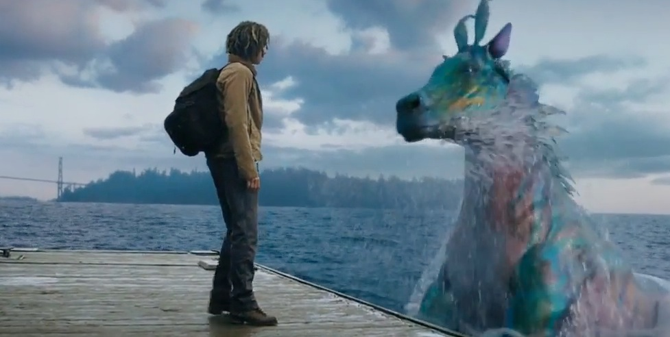 Percy's  half-brother Tyson (Douglas Smith), a cyclops, meets a mythical sea creature. (Photo courtesy of 21st Century Fox)