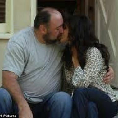 Albert (James Gandolfini) and Eva (Julia Louis-Dreyfus) kiss in Enough Said. (Photo: Fox Searchlight)