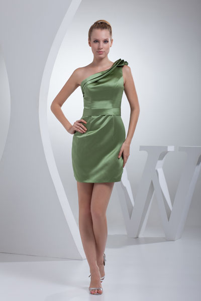 A green satin, one shoulder short/mini sleeveless bridesmaid dress. (Photo: thegreenguide.com)
