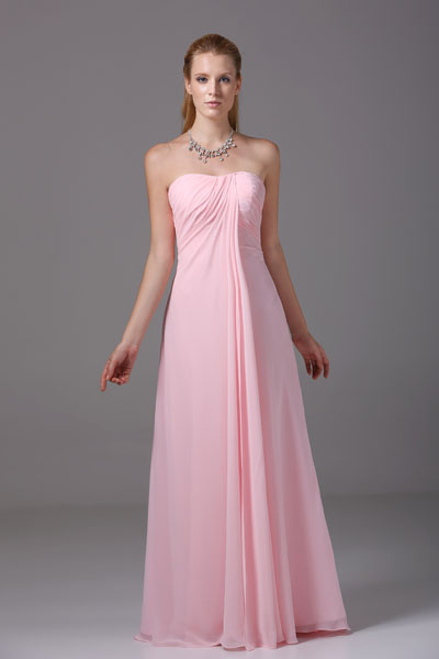 A pink, floor-length, strapless chiffon column bridesmaid gown. (Photo: thegreenguide.com)