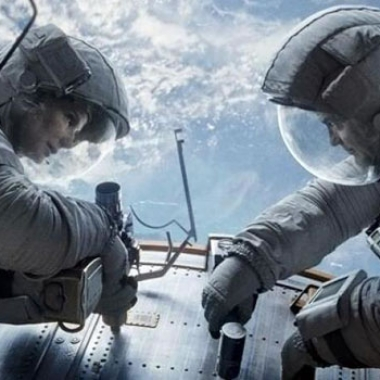 Sandra Bullock and George Clooney's Gravity finished in first for the third week. (Photo: Warner Bros.)