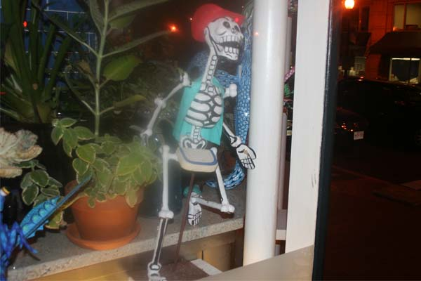 A catrinas, satirical skeletons made famous by Jose Guadalupe Posada, in the window of Oyamel. The skeletons have become an icon of the Mexican Day of the Dead. (Mark Heckathorn/DC on Heels)