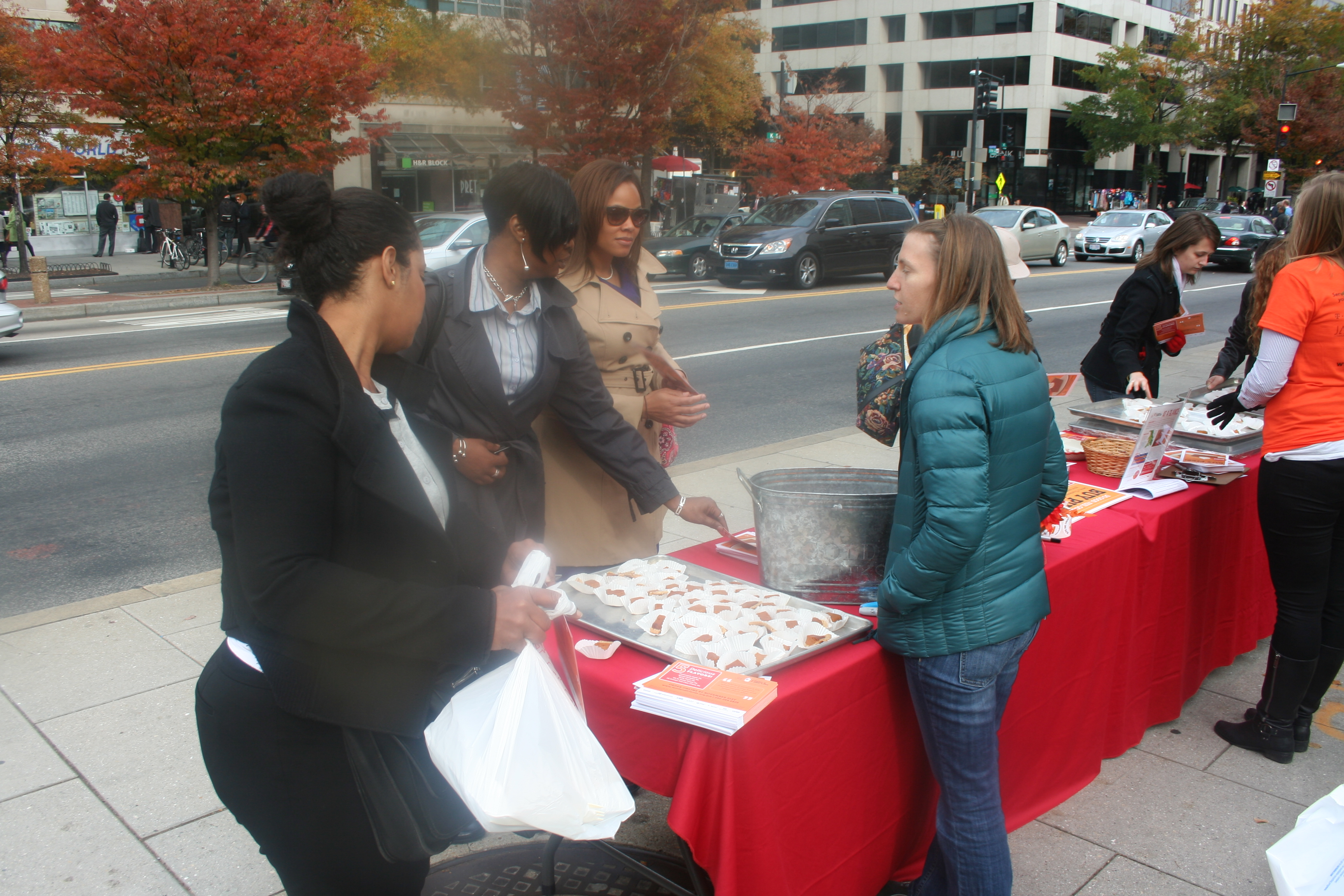 Volunteers pass out samples of apple and pumpkin pie at Farragut Square during  Pie Day on Nov. 5. Apple was the favorite of voters. (Photo: Mark Heckathorn/DC on Heels)