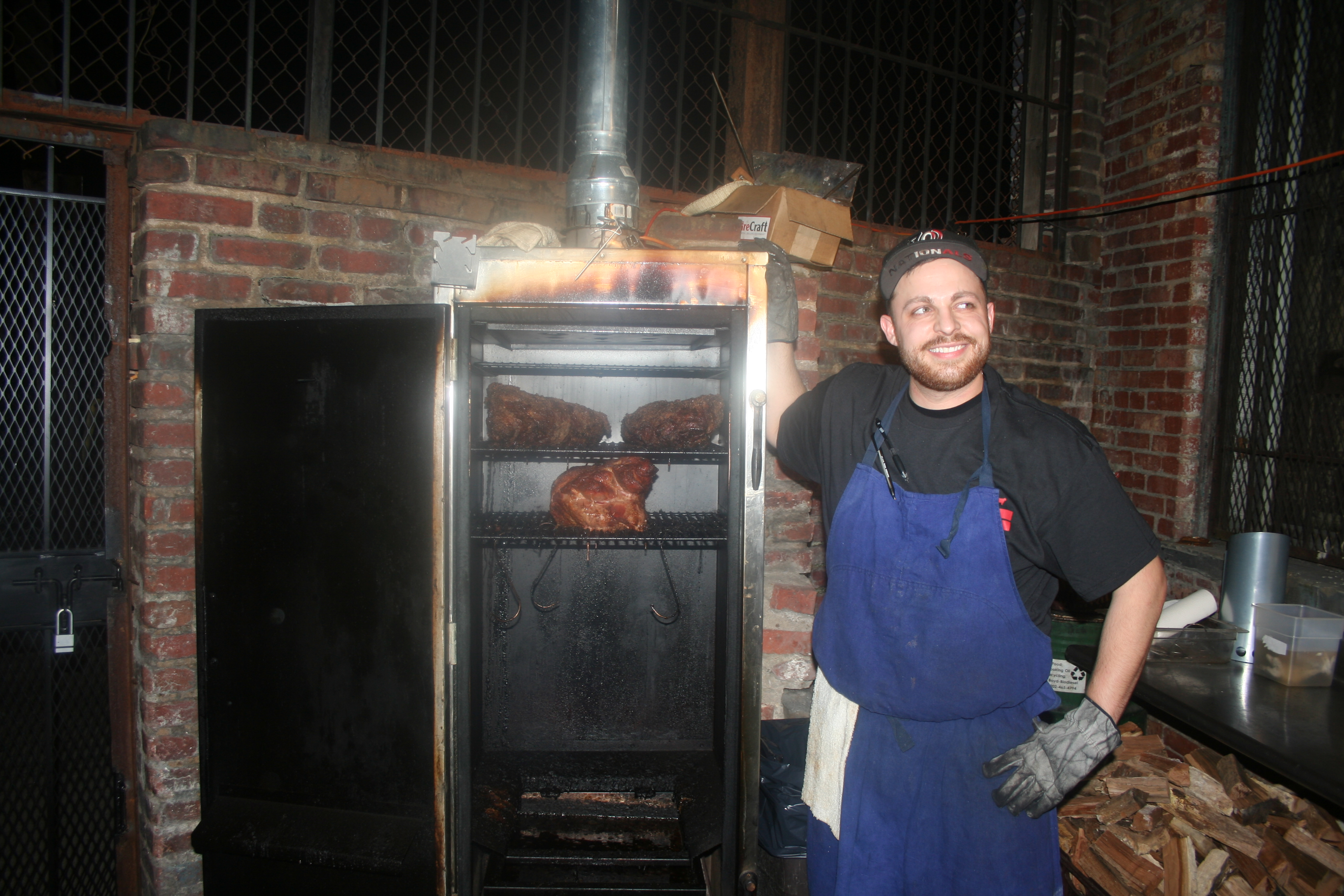 Pitmaster Rob Souderman at the DCity Smokehouse smoker. (Photo: Mark Heckathorn/DC on Heels)