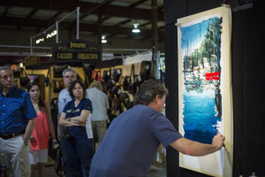 Visitors watch an artist at the Sugarloaf Crafts Festival. (Photo: Sugarloaf Mountain Works)