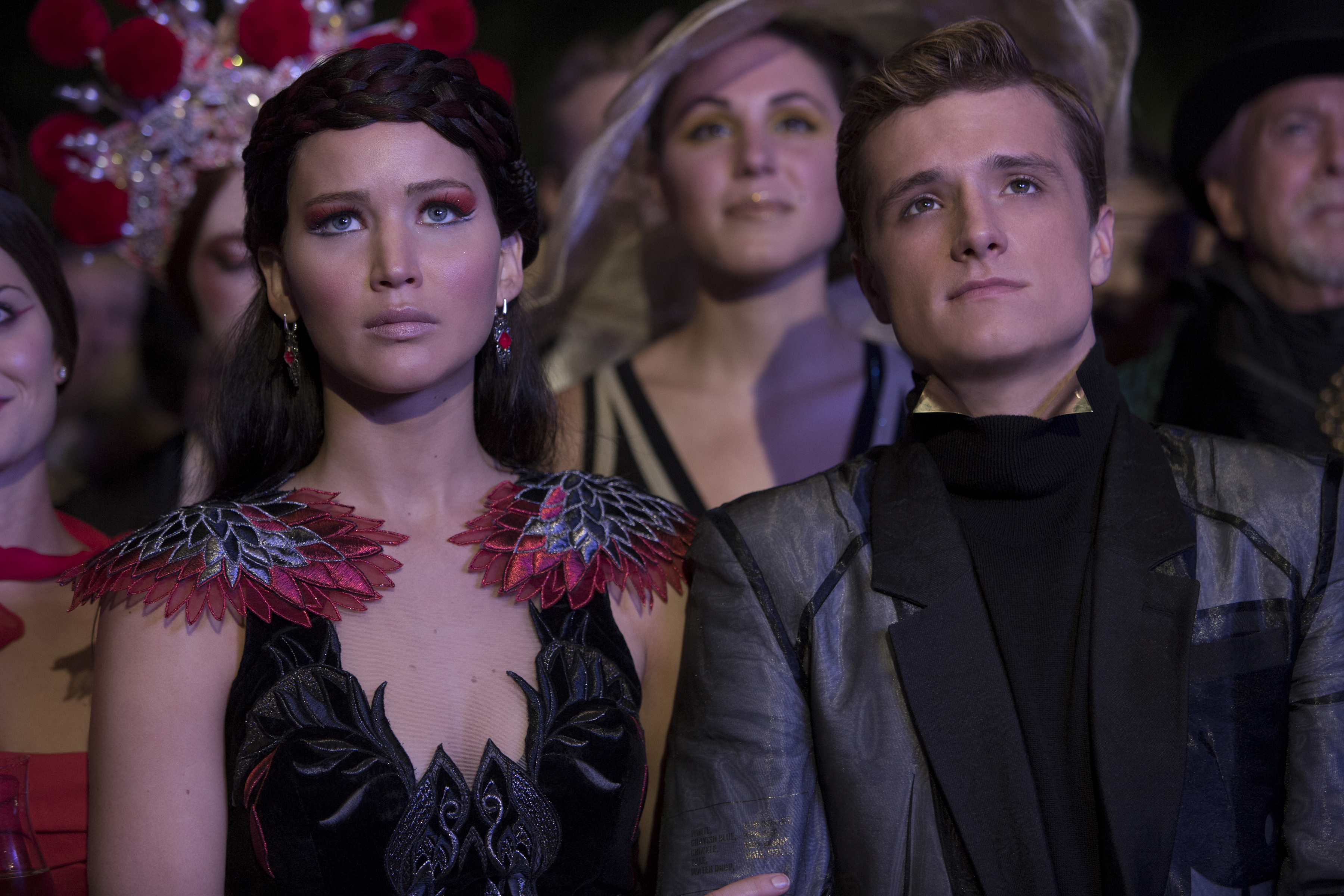 Katniss Everdeen (Jennifer Lawrence, left) and Peeta Mellark (Josh Hutcherson, right)  in The Hunger Game: Catching Fire. (Photo: Murray Close/Lionsgate)