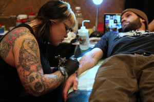 A tattoo artist tattoos a visitor at last year's D.C. Tattoo Expo. (Photo: Gary Robinette/Flickr)
