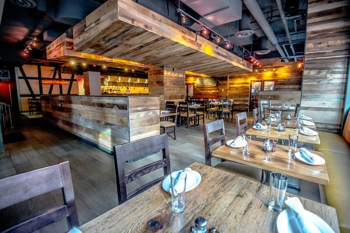 The dining room at City Tap House is done in earth tones, wood, stone and copper. (Photo: City Tap House)