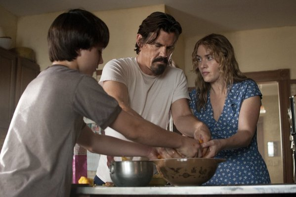 Gattlin Griffith, Josh Brolin and Kate Winslet in the pie making scene from Labor Day. (Photo: Dale Robinette/Paramount Pictures)