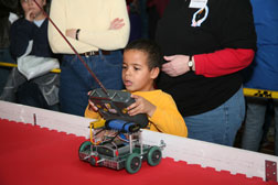 A boy explores robotics at the annual Discover Engineering Family Day. (Photo: F.T. Eyre)