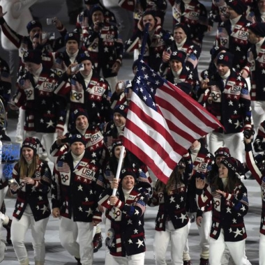 United States flag bearer Todd Lodwick leads the U.S. Olympic team onto the stage during the opening ceremony for the Sochi 2014 Olympic Winter Games. (Photo: Robert Hanashiro/ USA Today Sports)