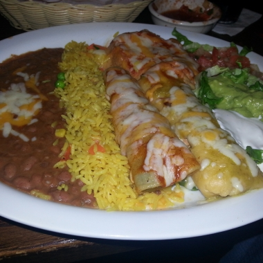El Tio's Mexican platter with (l to r) refried beans, Mexican rice, beef enchilada, chile rellano (rear), chicken tamale (front), pica de gallo, lettuce, sour cream and guacamole. (Photo: Mark Heckathorn/DC on Heels)