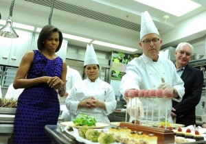 Bill Yosses (right), who is stepping down as the White House pastry chef, described the offerings for an upcoming formal dinner to Michelle Obama and culinary students in 2009. (Pool photo by Kevin Dietsch)