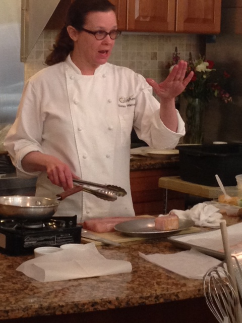 Owner Susan Watterson instructing the class on cooking technique. (Photo: Richard Barry/DC on Heels)