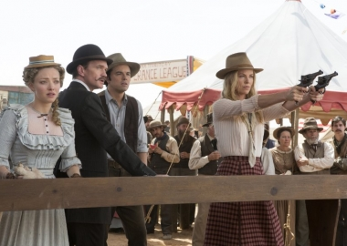 Amanda Seyfried, Neil Patrick Harris, Seth MacFarlane and Charlize Theron at the county fair's shooting gallery. (Photo: Universals Pictures)