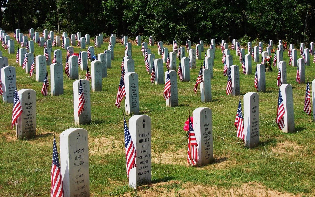 Graved at Arlington National Cemetery are decorated with flags for Memorial Day. (Photo: Indian Barrister)