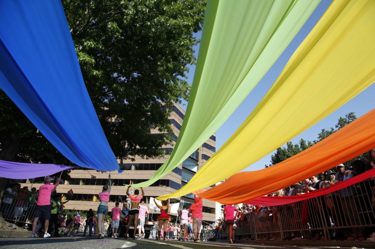 Participants carry rainbow banners during the 2013 Capital Pride Parade.  (Photo: Jonathan Ernst / Reuters)