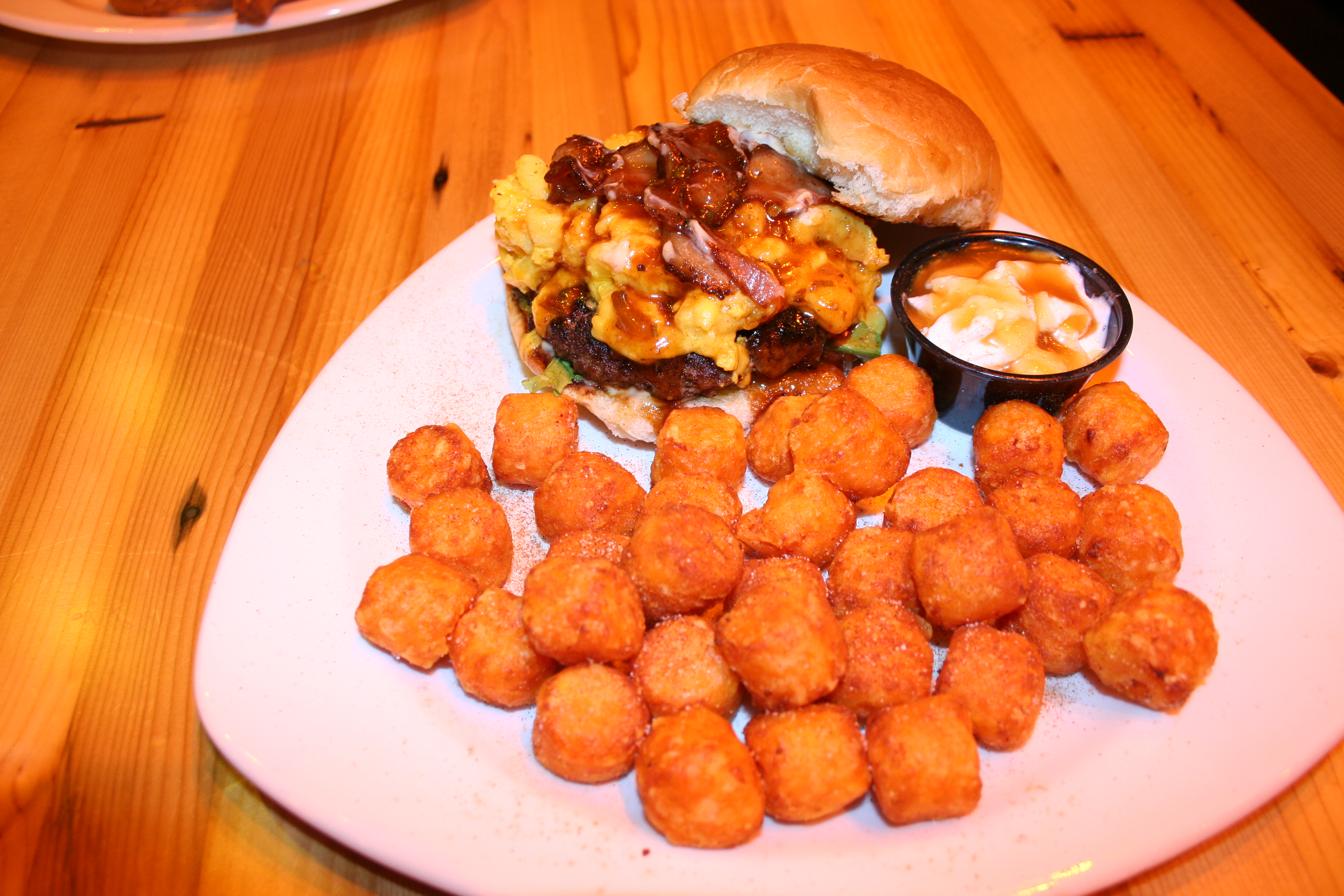 The mac n cheese burger with sweet potato tots and whipped cream/maple syrup dipping sauce. (Photo: Mark Heckathorn/DC on Heels)