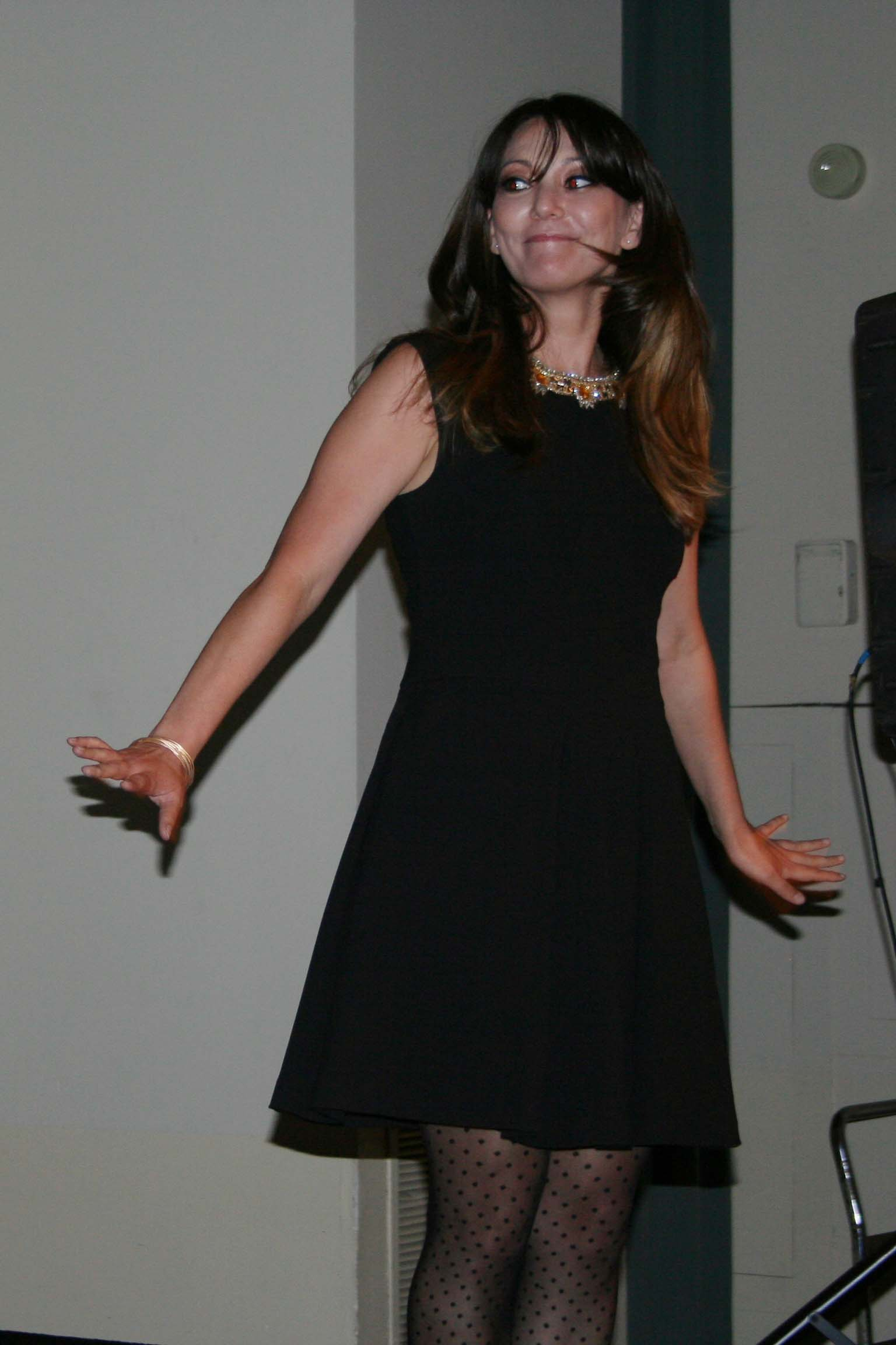 Kim Sullivan, a colon cancer survivor, wears a black Tracey Reese dress with a gold embroidered neckline. (Photo: Mark Heckathorn/DC on Heels)