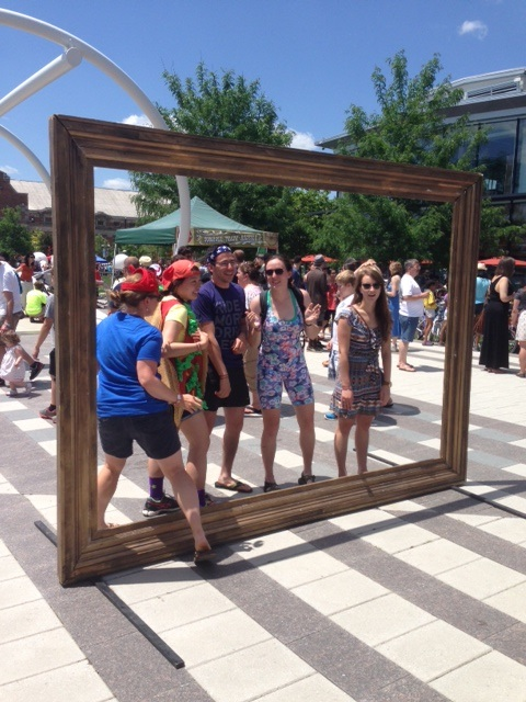 Festival goers pose in front of an outsized empty frame (Photo: Richard Barry/DC on Heels)