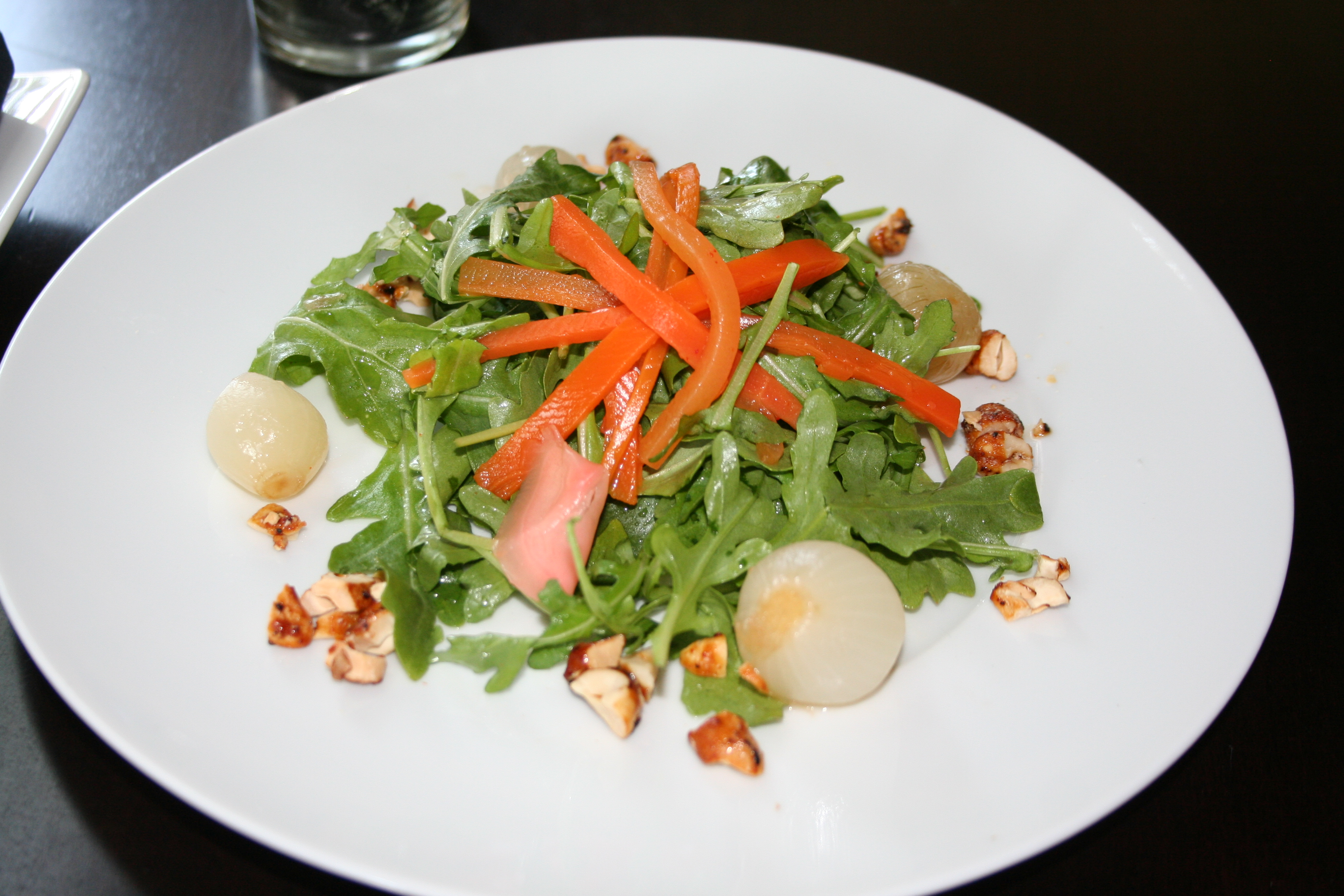 The pickled salad at Chaplin's is made with house-made spicy white pearl onions, sweet pickled ginger and sweet pickles on local arugula with a house-made sweet vinegar. (Photo: Mark Heckathorn/DC on Heels)