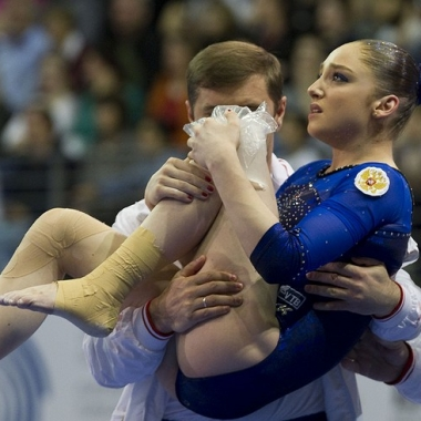 Aliya Mustafina of Russia gets assistance after suffering from an injury at the vault. (Photo: Gero Breloer/AP)