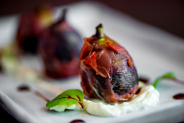 Chef Barry Koslow will serve southern European-inspired fare—such as this Serrano-ham-wrapped fig—at Pinea, opening in September. (Photo: Daniel Swartz/W Hotel)