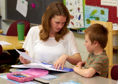 A teacher works with an elementary student. (Photo: Penn State)