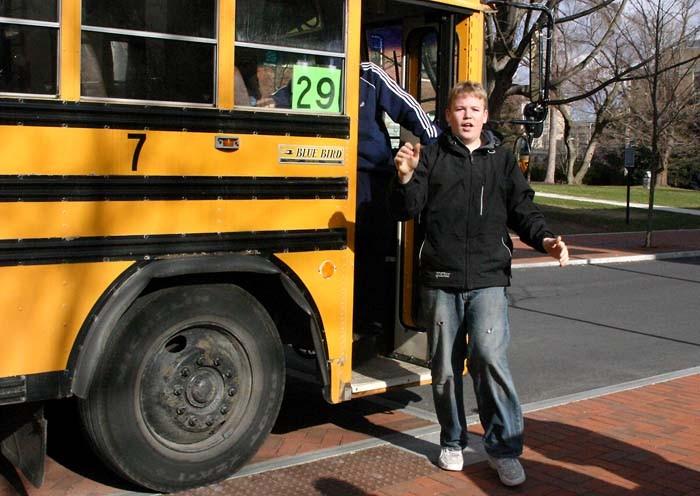 High school students exit their bus. (Photo: Annamarie Mountz/Penn State)