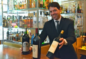Blue Duck Tavern's general manager Joseph Cerione shows off some of the Cavs that will be served. (Photo: BisNow)