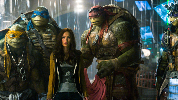 Michelangelo, Leonardo, Megan Fox as April O'Neil, Raphael and Donatello (L to R) in Teenage Mutant Ninja Turtles. (Photo: Paramount Pictures)