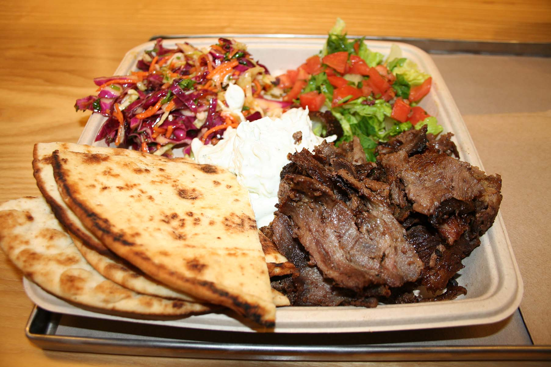 The Yerro plate includes lamb/beef gyro meat, house-baked pita, Aegean salad (top left), lettuce and tomato and traditional tzatziki sauce. (Photo: Mark Heckathorn/DC on Heels)