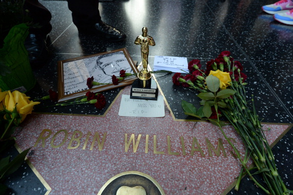 Flowers and momentos left by fans are seen at Robin Williams' star on the Hollywood Walk of Fame. (Photo: Robyn Beck/AFP/Getty Images)