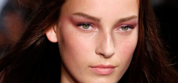 Tom Pecheux created a beautiful, translucent, almost bruise-like violet eye paired with a soft pink lip for Derek Lam. (Photo: JP Yim/Getty Images)