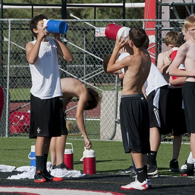 To prevent heat stroke, athletes should be properly hydrated before practice and take frequent water breaks in the shade. (Photo Daniel Friedman)