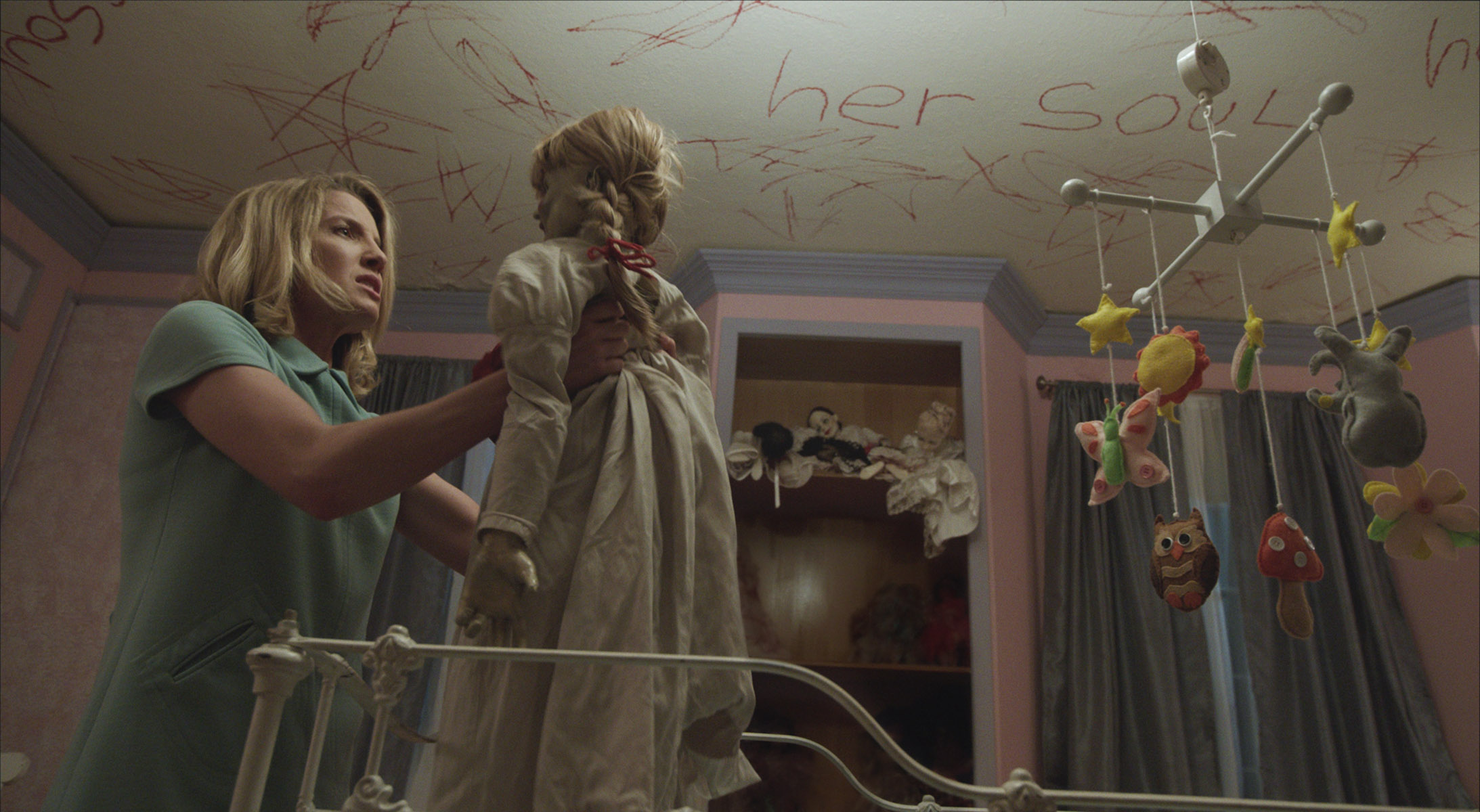Mia (Annabelle Wallis) finds the Annabelle doll in her missing daughter's crib. (Photo: Warner Bros. Pictures)