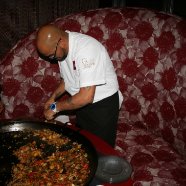 A chef serves paella with seasonal vegetables from a big paella pan at last year's paella festival. (Photo: Mark Heckathorn/DC on Heels)