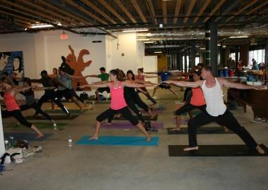 Bendy Brunch participants practice yoga among art at the old Wonder Bread Factory. (Photo: Mark Heckathorn/DC on Heels)